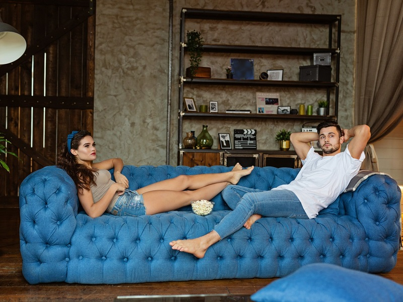 a couple lying on the sofa at home in quarantine during coronavirus outbreak