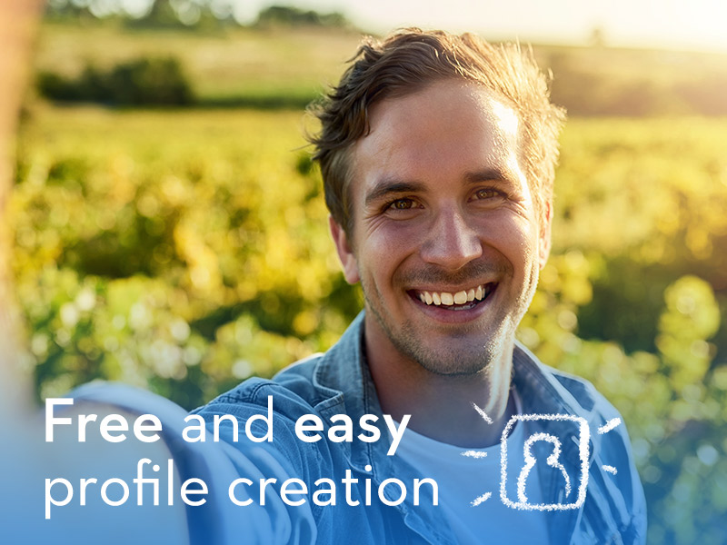 attractive man smiling in field answering is Zoosk free?