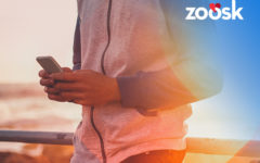 man-using-his-phone-to-determine-zoosk-cost